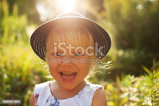 istock Cute little cheerful blonde girl 588961994