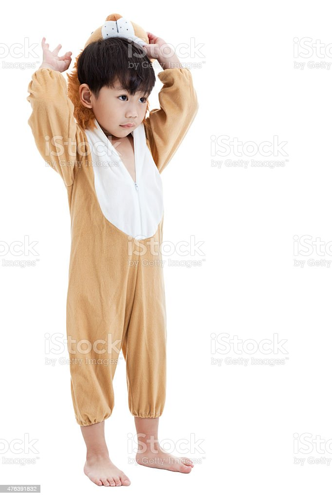 Cute little child dressed in lion suit stock photo