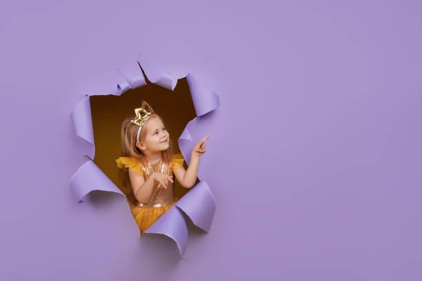Cute little child girl in princess costume breaks through a colored picture id1191060420?b=1&k=6&m=1191060420&s=612x612&w=0&h=lkgqs63en4bei5wlev3c31bnf avlu0fnie a hm5au=