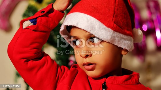 istock Cute little child portrait at home 1125662353