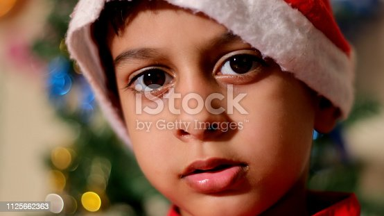 istock Cute little child portrait at home 1125662363