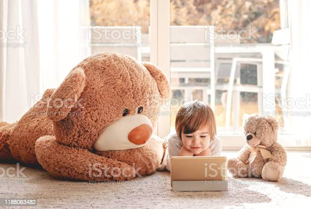 Cute little child watching cartoons on digital tablet device lying on picture id1188063482?b=1&k=6&m=1188063482&s=612x612&h=wrohqbbbvthjz2sjwjitagkbstsl62haoztokwr4vfo=