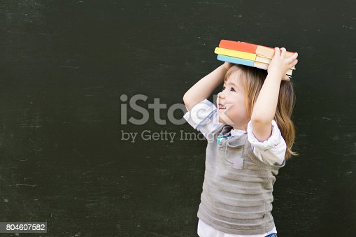 istock Cute Little Child With Books 804607582