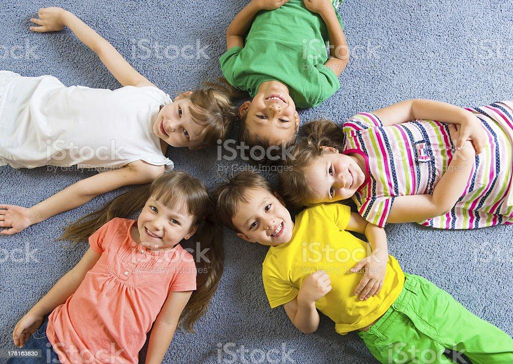 Cute little children lying on floor royalty-free stock photo