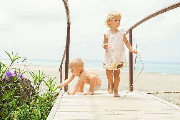 Cute little children playing outdoor, seaside stock photo