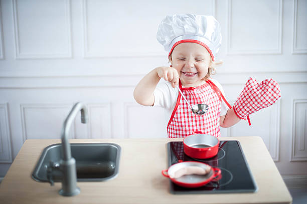 Cute little cook stock photo
