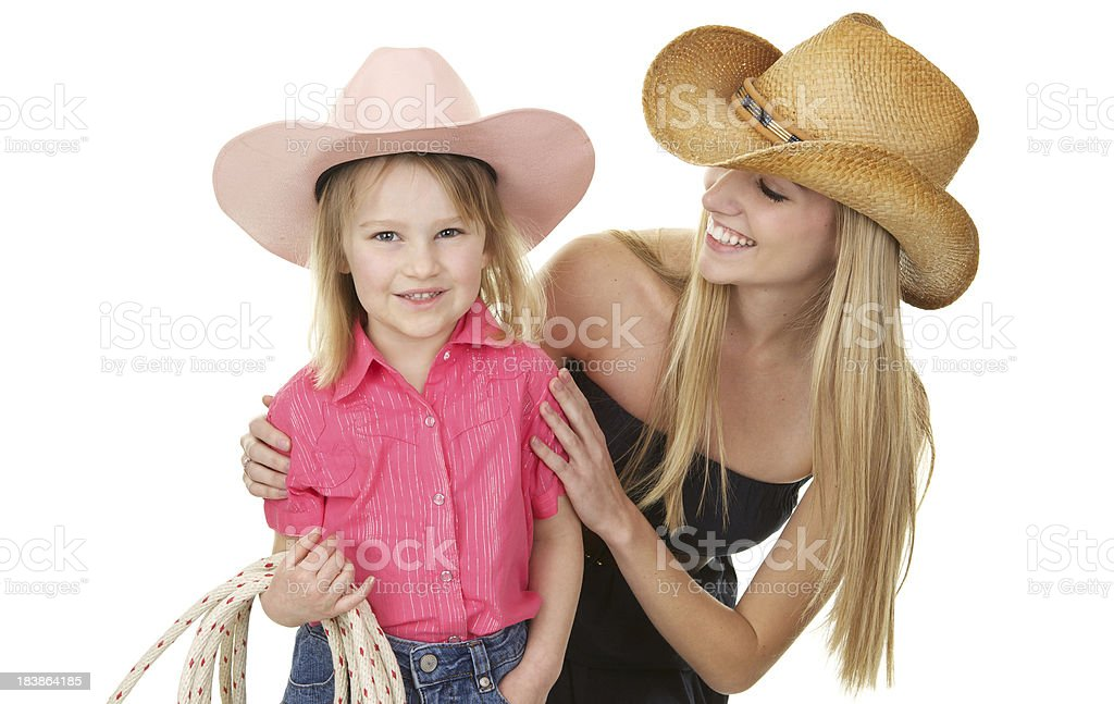 300e7c4d1 Cute Little Cowgirl With Big Sister Stock Photo - Download Image Now ...