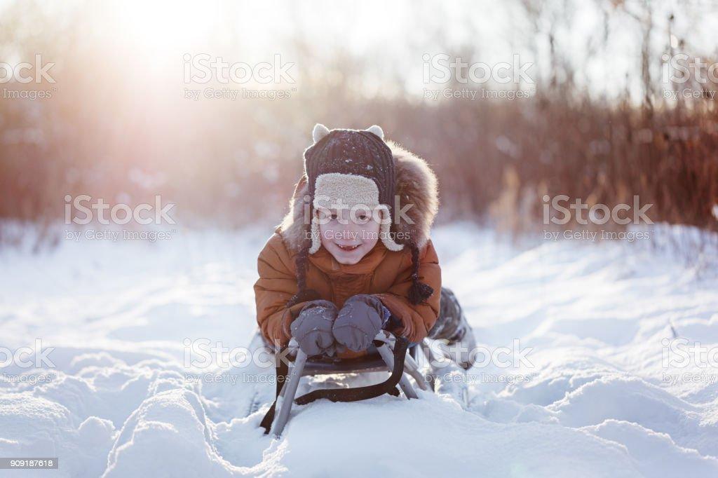 19267beb5 Cute Little Funny Child Boy In Warm Winter Clothes Having Fun On ...