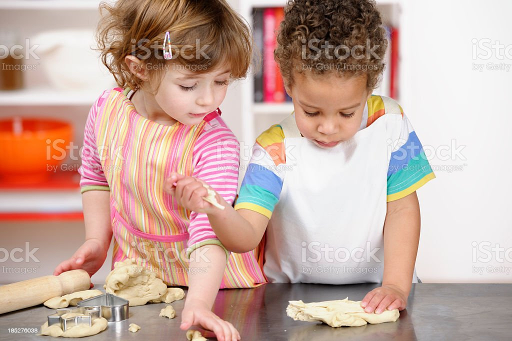 Cute Little Girl And Boy Playing With Dough royalty-free stock photo