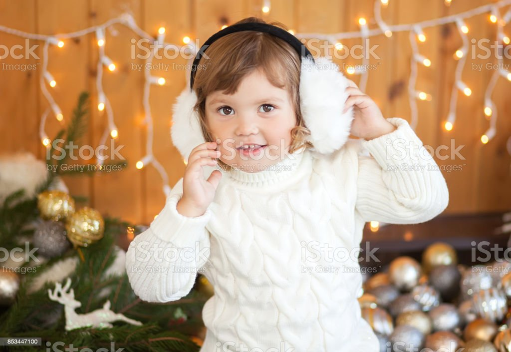 97f5745ddcef Cute little girl and christmas decor, beautiful light. royalty-free stock  photo