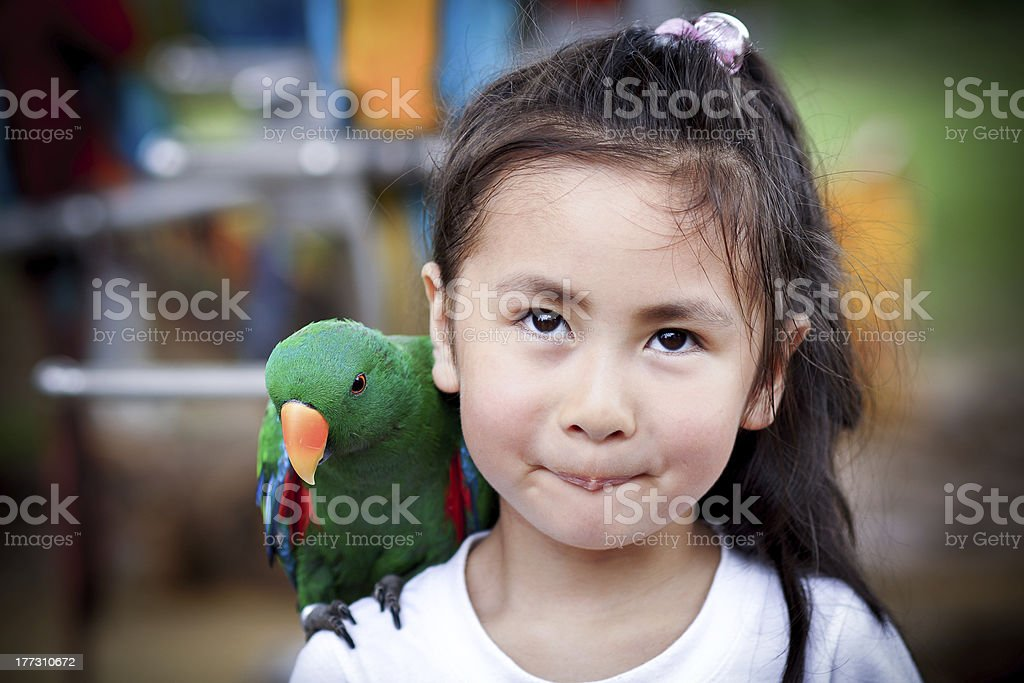 cute little girl and parrot royalty-free stock photo