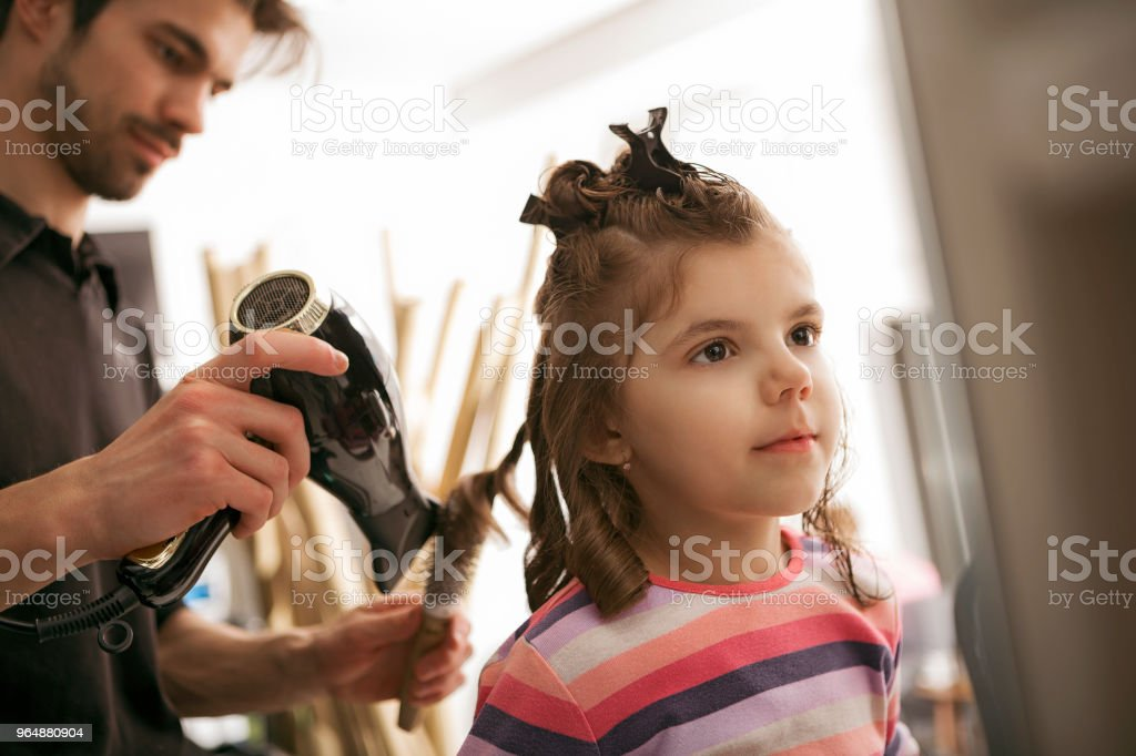 Cute little girl at hairdresser royalty-free stock photo