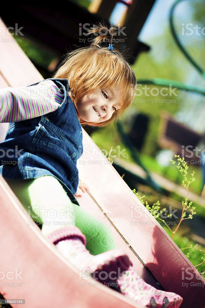 Cute little girl at the playground royalty-free stock photo