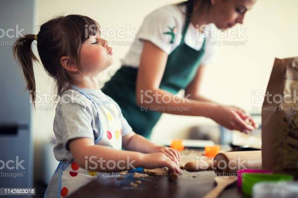 Cute little girl baking at home with mom picture id1142653018?b=1&k=6&m=1142653018&s=612x612&h=s6srglrnykafrevwa4g7zdojw253e6cpi6qm t81dow=