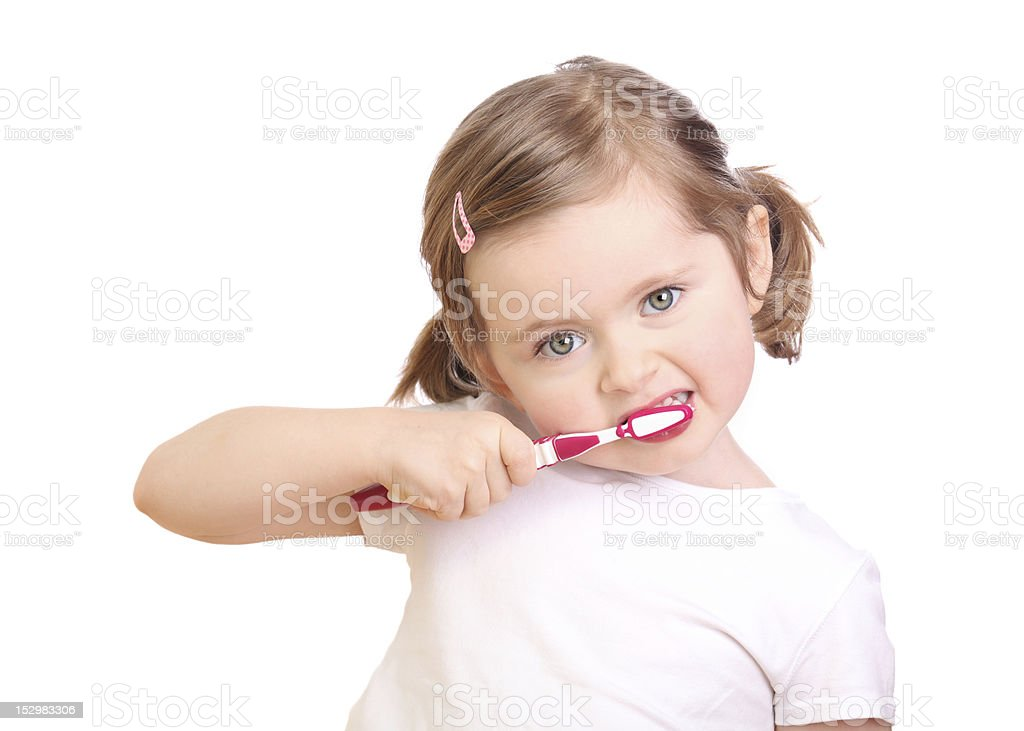 A cute little girl brushing her teeth royalty-free stock photo