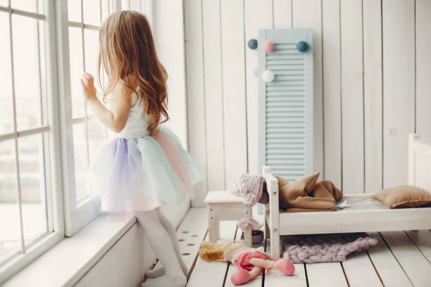 Cute little girl dancing at home stock photo