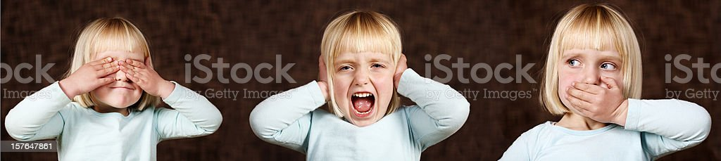 Cute little girl demonstrates see, hear,and speak no evil royalty-free stock photo