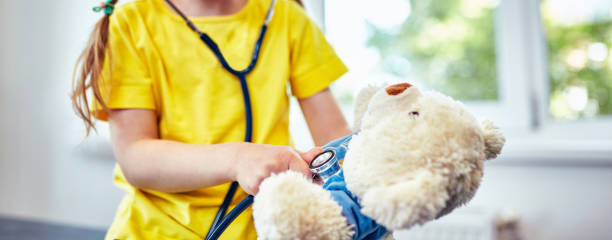 Cute little girl doctor on her rounds stock photo