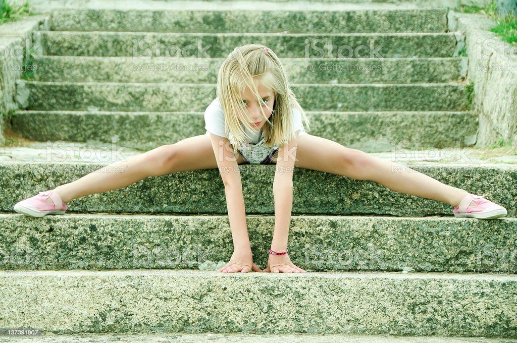 Cute Little Girl Doing Gymnastics royalty-free stock photo