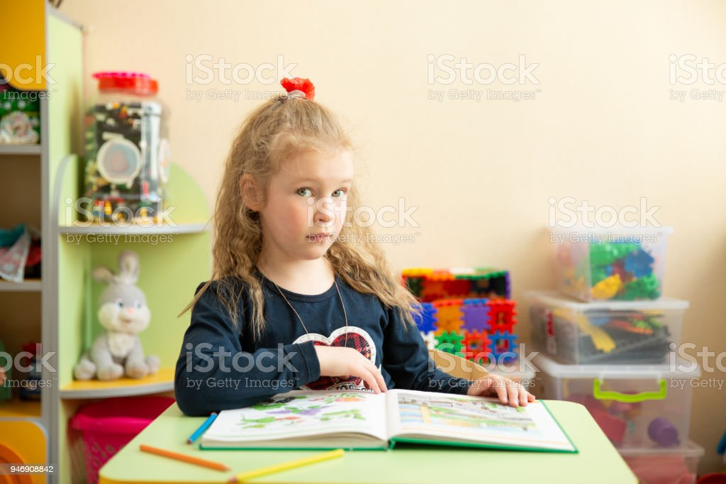 Cute Little Girl Doing Homework Reading A Book Coloring Pages Writing And Painting Teaching In Kindergarten Stock Photo Download Image Now Istock