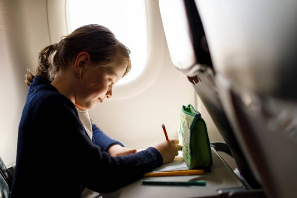 Cute Little Girl Drawing A Picture During Flight Stock Photo Download Image Now Istock