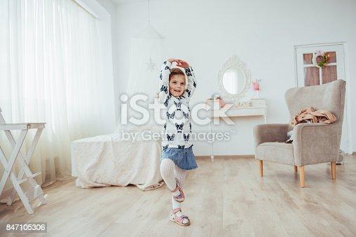 istock Cute little girl dreams of becoming a ballerina. Girl studying ballet. 847105306