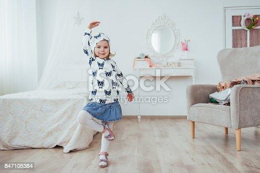 istock Cute little girl dreams of becoming a ballerina. Girl studying ballet. 847105384