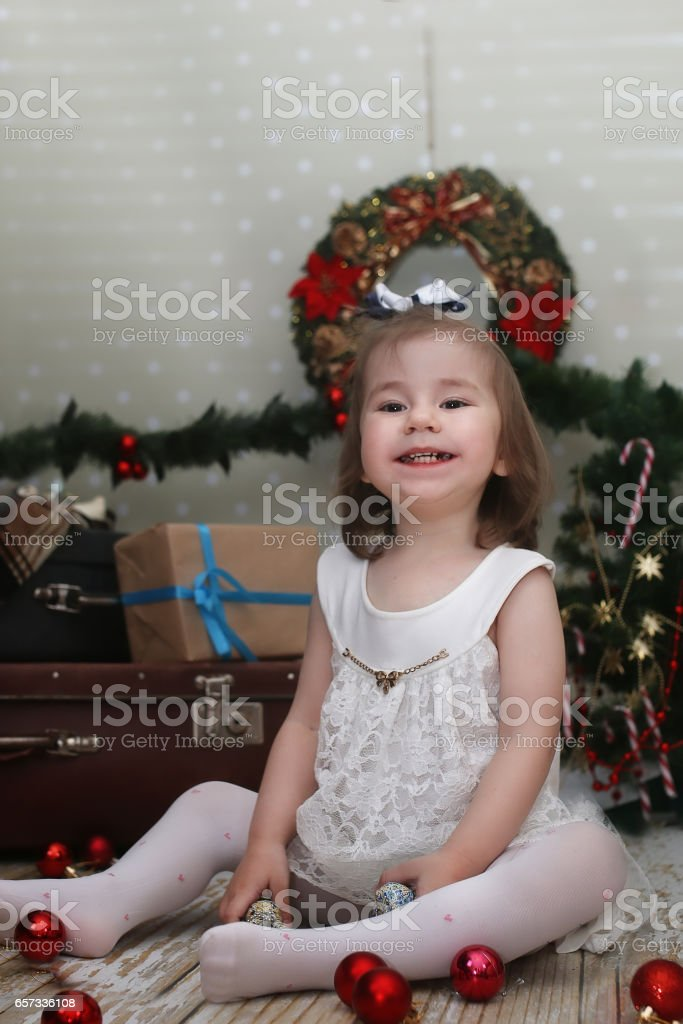 e07529d83a8c cute little girl dresses up Christmas tree royalty-free stock photo