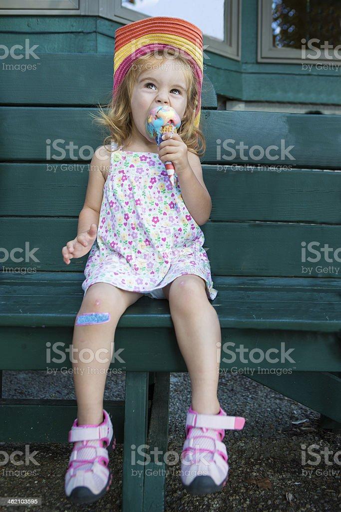Cute little girl eating an ice cream stock photo