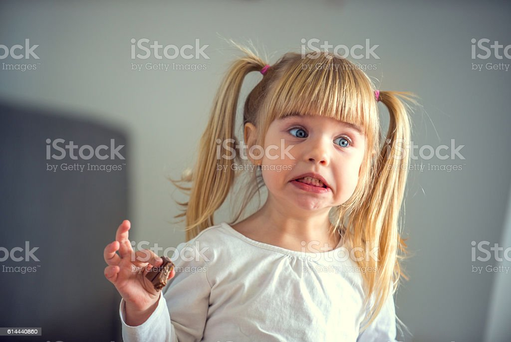 Cute little girl eating chocolate stock photo