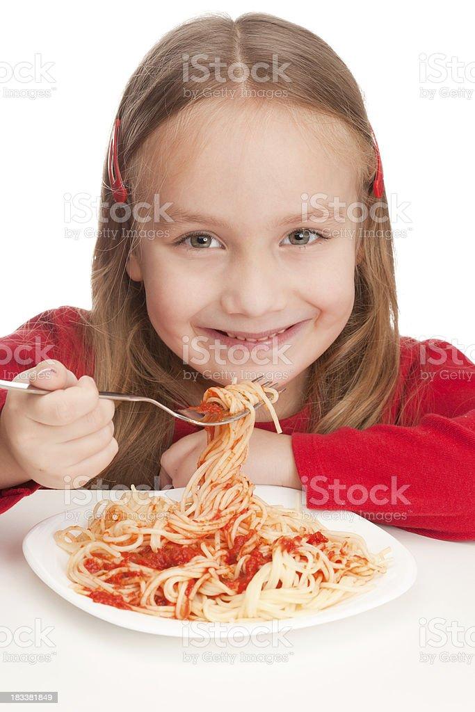 Cute little girl eating spaghetti royalty-free stock photo