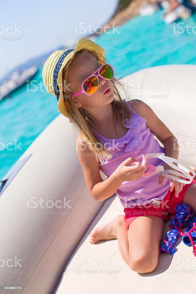 Cute little girl enjoying sailing on boat in open sea stock photo