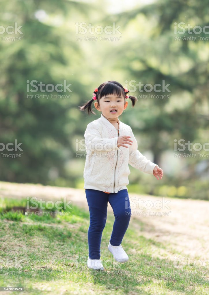 Cute little girl happy runing stock photo