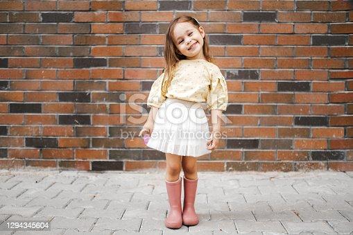 istock Cute little girl having fun time in the nature 1294345604