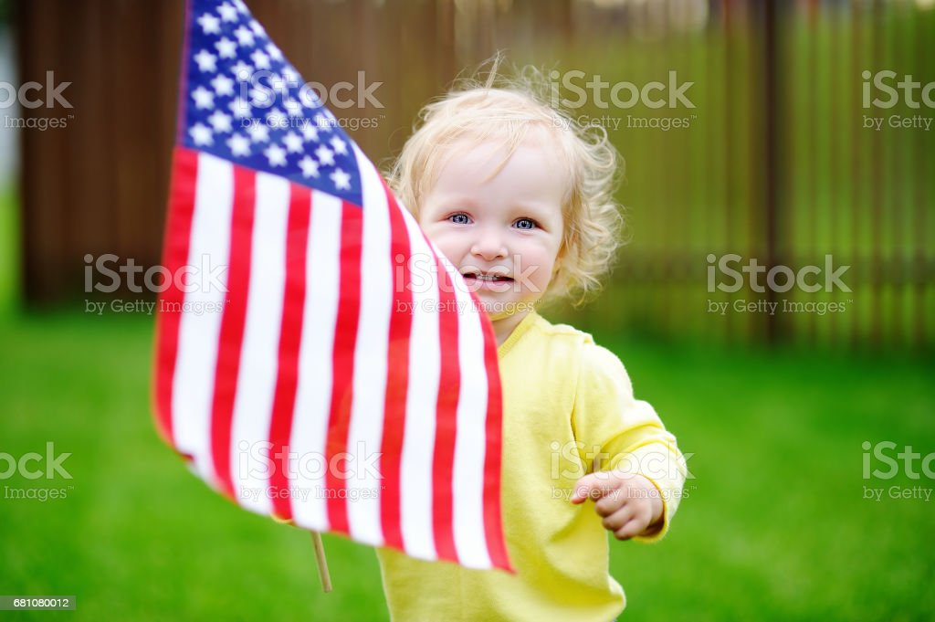 Cute little girl holding american flag stock photo