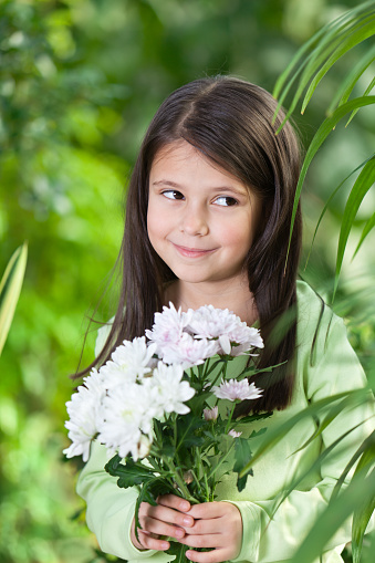 Little girl holding flowers Stock Photo free download