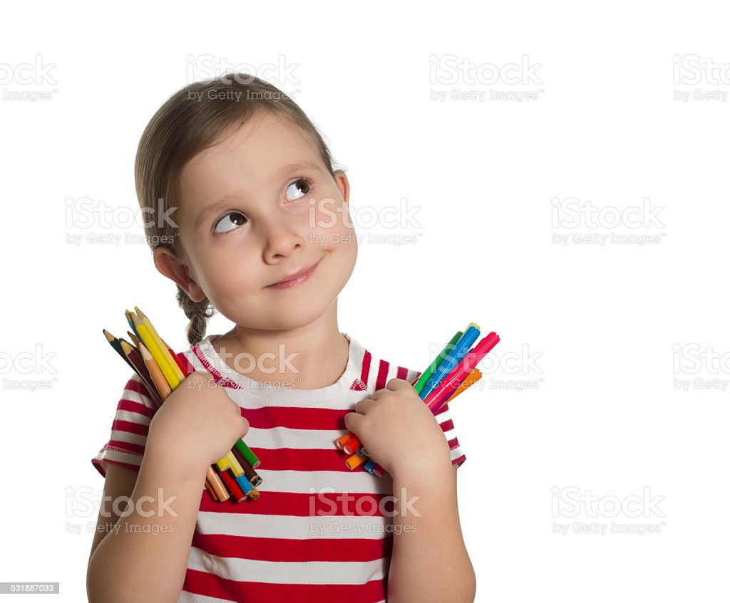 cute little girl holding colourful pencils and markers looking u stock photo