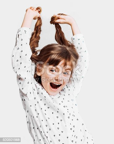 istock Cute little girl holding her hair 520501568