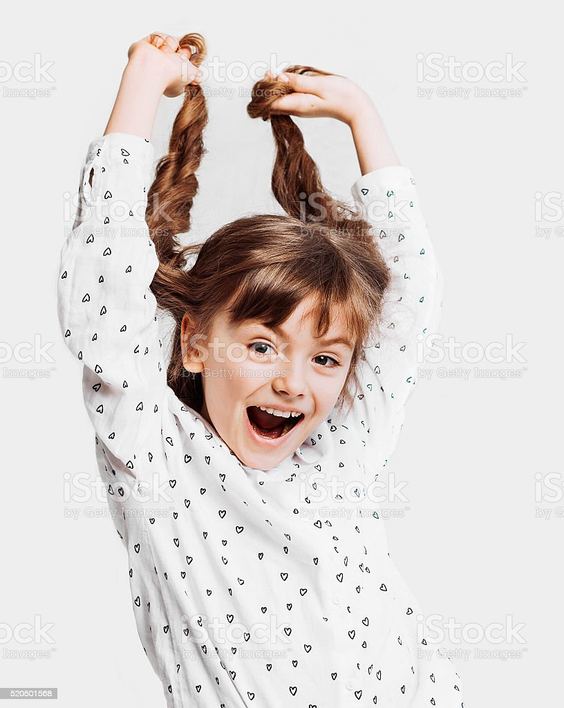 Cute little girl holding her hair stock photo