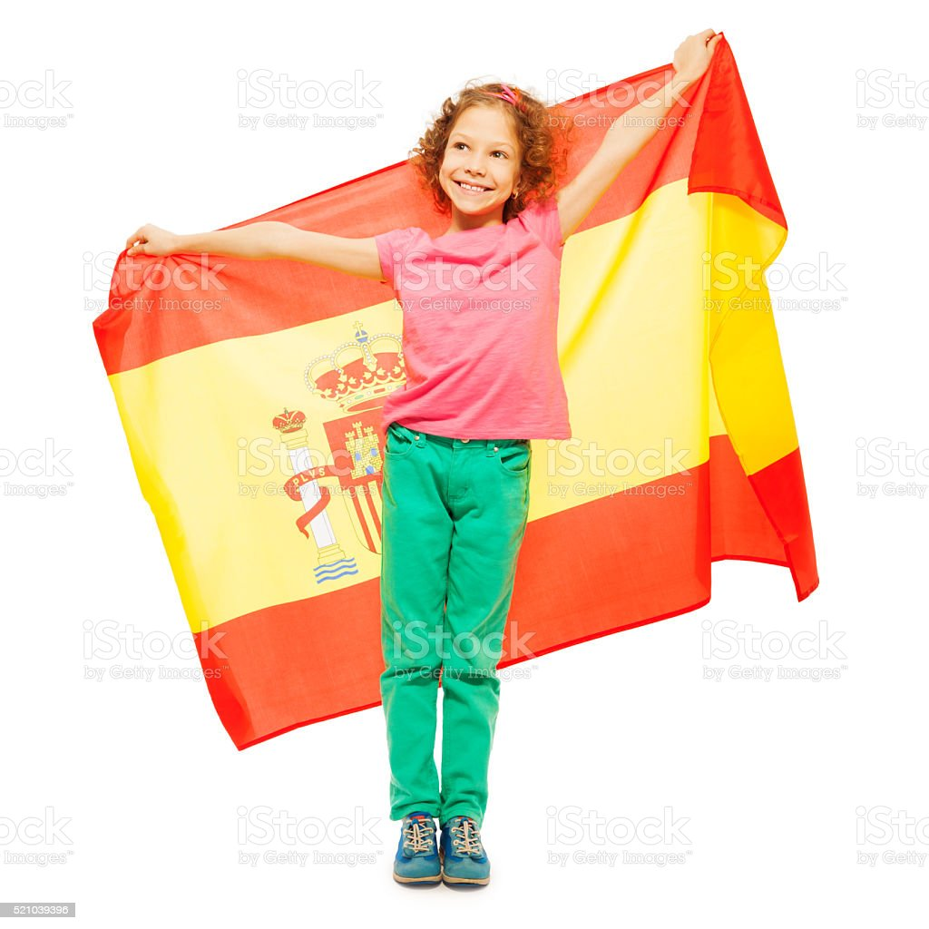 Cute little girl holding Spanish flag behind her stock photo