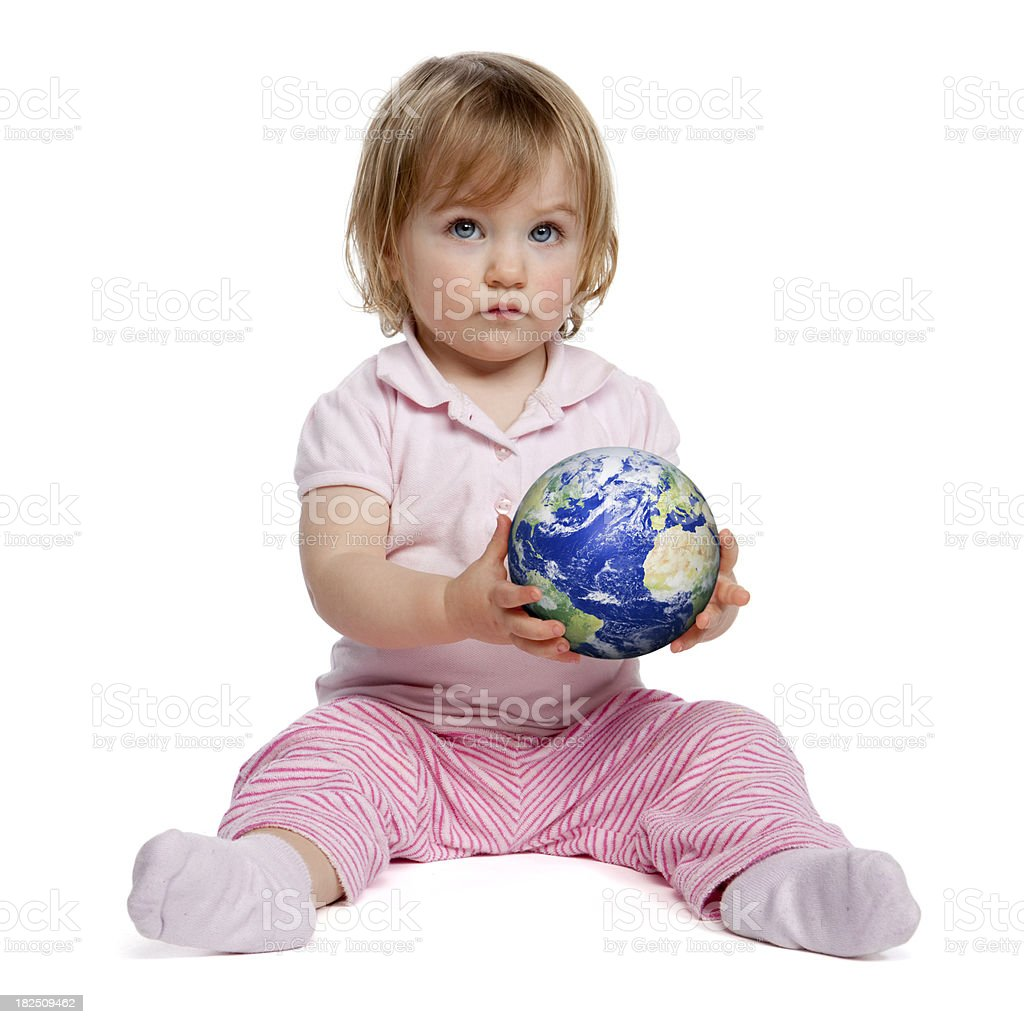 Cute little girl holding the world royalty-free stock photo