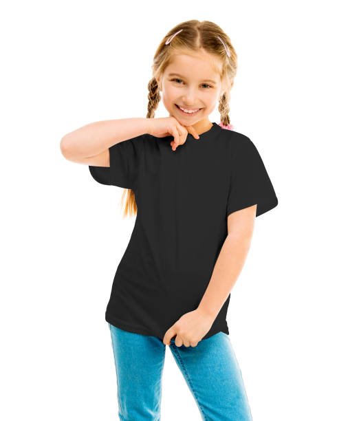cute little girl in a black T-shirt and blue jeans cute little girl in a blacke T-shirt and blue jeans on a white background shows a T-shirt on black shirt stock pictures, royalty-free photos & images