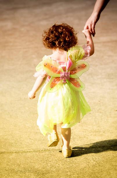 cute little girl in a fairy dress walking - prinzessinnen tutu stock-fotos und bilder