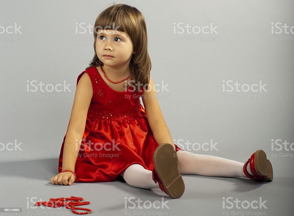 Cute little girl in a red dress royalty-free stock photo