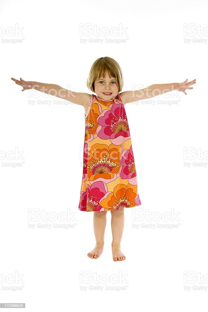 Cute little girl in dress with arms stretched out royalty-free stock photo