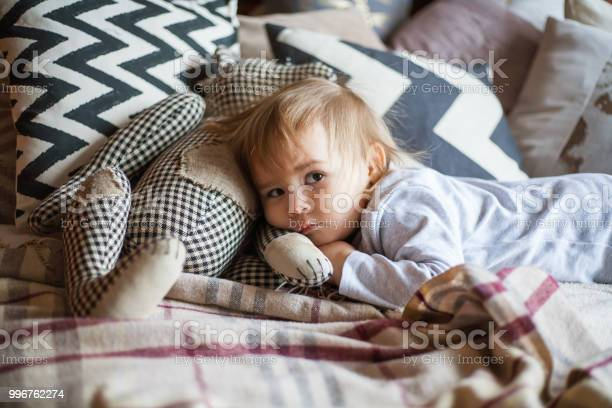 Cute little girl in pajama hugging her toy hare on the bed at home picture id996762274?b=1&k=6&m=996762274&s=612x612&h=xsc 4mfvclvedi9yexk7ygsdkwbneapafkawqq6ijb0=