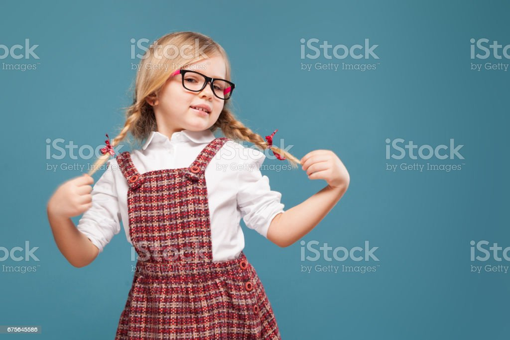 Cute little girl in red dress, white shirt and glasses royalty-free stock photo