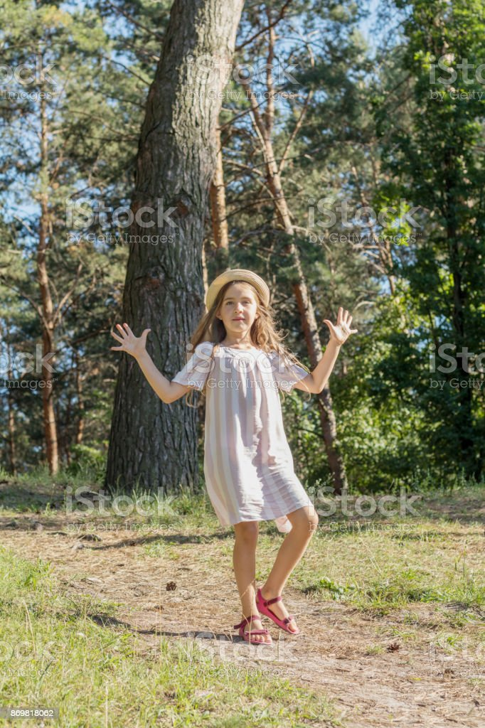 Cute little girl in the city park royalty-free stock photo