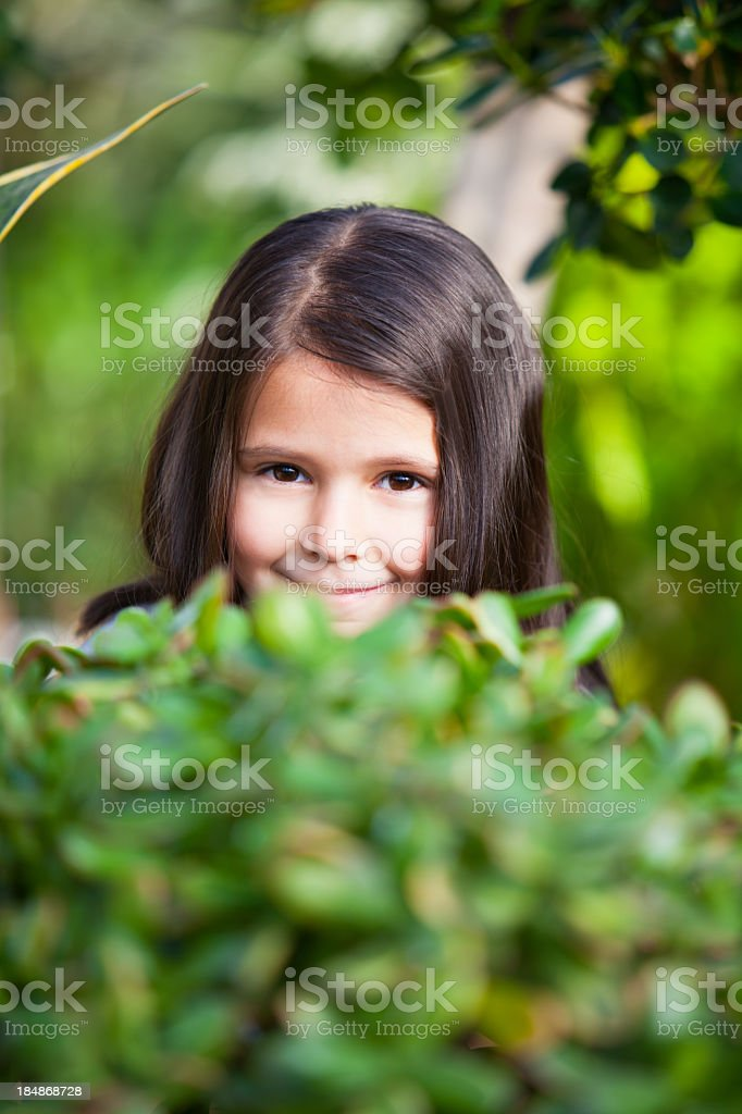 Cute little girl in the garden royalty-free stock photo