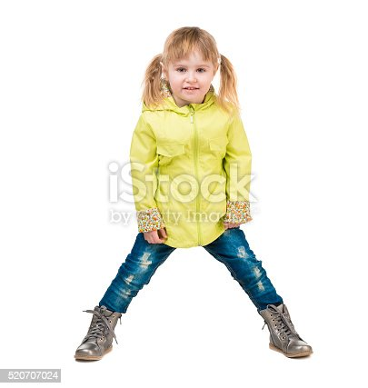 istock cute little girl in yellow coat 520707024